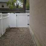 5-foot solid board vinyl fence with a gate