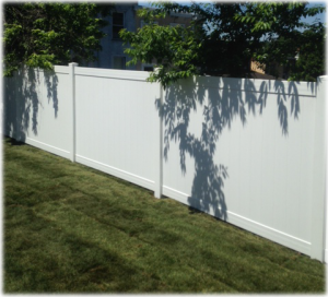 6-foot high white solid board vinyl fence - a