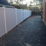 6-foot white solid board vinyl fence with New England caps