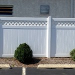 6-foot white vinyl lattice topped fence