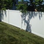 6-foot high white solid board vinyl fence