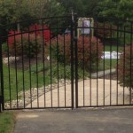 Black aluminum fence with rainbow double gate