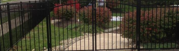 Black aluminum fence with rainbow double gate