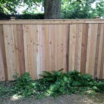 Red cedar solid board privacy fence with capping board